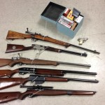 Authorities said these weapons were found Wednesday at the Lancaster home of an AB 109 offender who was targeted for violating his post-release conditions. (Photo courtesy LASD)
