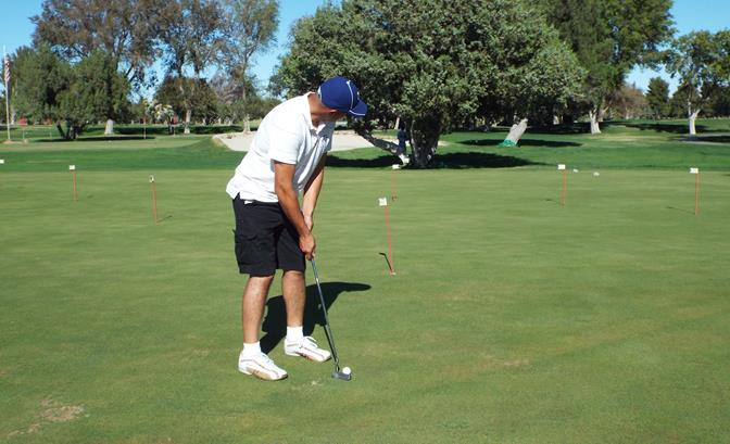 Lancaster Community Relations Deputy Miguel Ruiz tees off at the 19th annual Duke Bloom Memorial Golf Tournament. (Photo by LUIS MEZA)