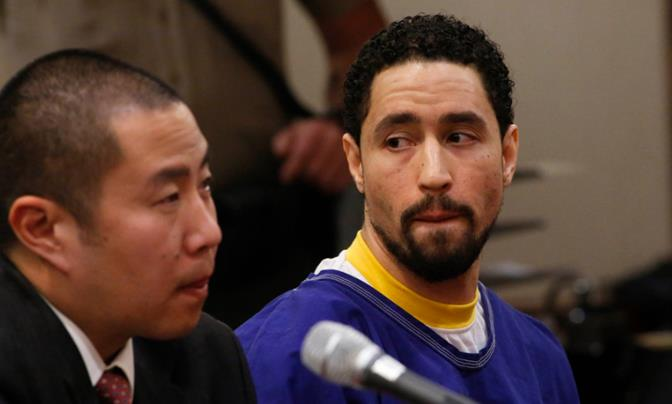 Defense attorney Al Kim, left, and Alex Donald Jackson, right, react as Jackson's brother Vincent Jackson pleads for leniency during the sentencing hearing in an Antelope Valley courtroom Friday. Jackson was sentenced Friday to 15 years to life in state prison. (Photo courtesy Anne Cusack/Los Angeles Times)