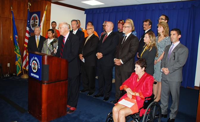 A broad coalition of business leaders, elected officials and union workers join Supervisor Michael Antonovich for a press conference Monday, Oct. 20 at the Kenneth Hahn Hall of Administration  in Los Angeles. (Contributed)
