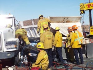 Firefighters worked for about 25 minutes to extricate 57-year-old Patricia L. Socha from her BMW, according to Battalion Chief Wes Anzai. (LUIS MEZA)