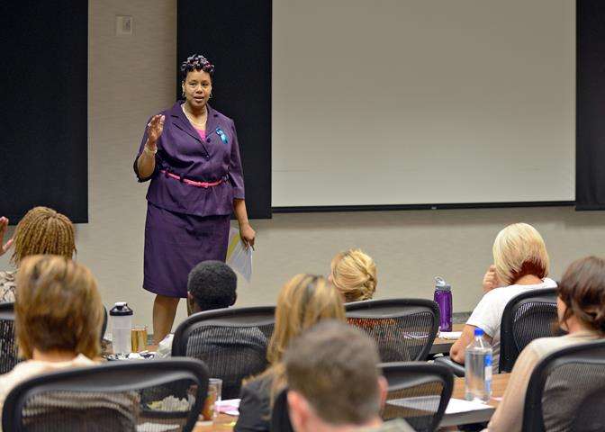 a Toyia Conway-Hampton, founder, CEO and director of the Two-Lifestyles Women Empowerment Program, speaks to Edwards personnel during an interactive workshop Oct. 9 at the Airman and Family Readiness Center in recognition of Domestic Violence Awareness and Prevention Month. (U.S. Air Force photo by Jet Fabara)