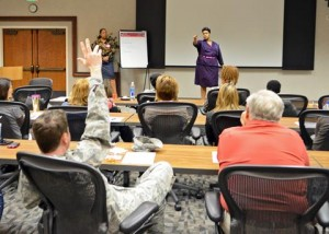 Conway-Hampton challenged attendees to answer questions regarding different forms of abuse. (Jet Fabara)