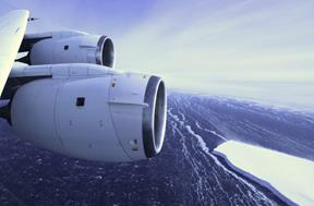 NASA's DC-8 research aircraft, shown flying over an Antarctic sea ice shelf on a prior IceBridge mission, is flying scientists and instruments over Antarctica this fall to study changes in the continent's ice sheet, glaciers and sea ice. (NASA photo)