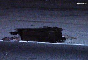 A damaged rolling suitcase was at the collision scene. (LUIS MEZA)