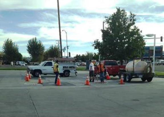 Joey Gorman said he snapped this photo on October 3 of inspectors working at the Shell gas station on the corner of 10th Street East (Challenger) and Avenue K. The station had stopped selling any unleaded fuel by this time.