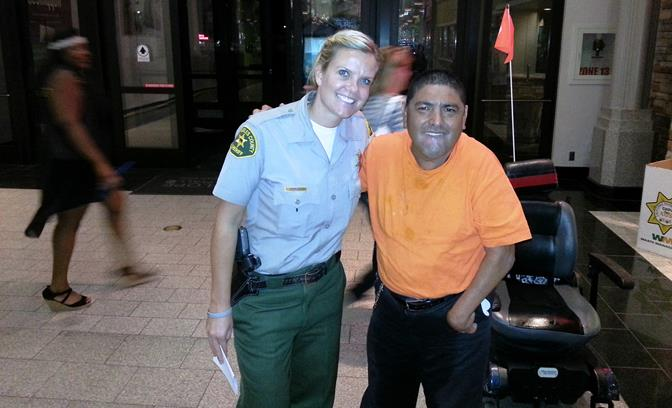 """On Thursday, Oct. 16, the Los Angeles County Sheriff's Department and the Special Olympics joined efforts at the Palmdale Red Robin for the annual """"Tip-A-Cop"""" fundraiser. The event raised $2,707.60. Pictured are Deputy Jodi Wolfe of the Palmdale Sheriff's Station and Thomas Aguinaga. (Contributed photo)"""