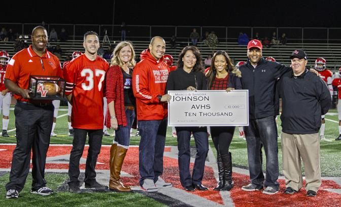 The Johnson family presents a $10,000 check to the Antelope Valley High School Athletics & Performing Arts Departments on Friday, Oct. 17, as part of the Marco and Sandra Johnson Foundation's 10-year $100,000 commitment.  (Contributed)