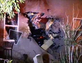 The car crashed through a block wall before crashing into the back of the home. (LUIS MEZA)