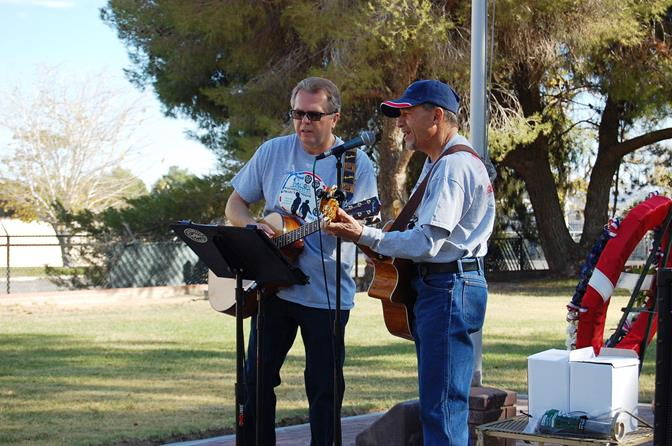 "Runaway band members Jim Hinds (left) and Doug Bonanno perform ""God bless America."" The duo also performed ""God bless the USA"" as some members in the audience sang along."