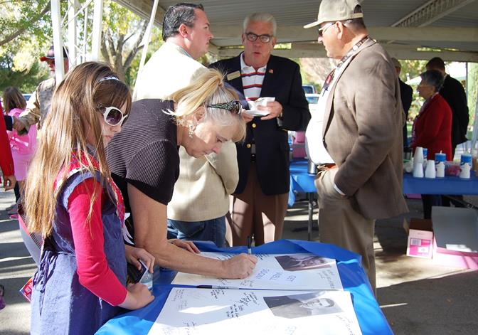 Attendees were given the opportunity to sign Get Well cards sending message of encouragement to ailing World War II veterans Walt Primmer Flora Belle Reece.