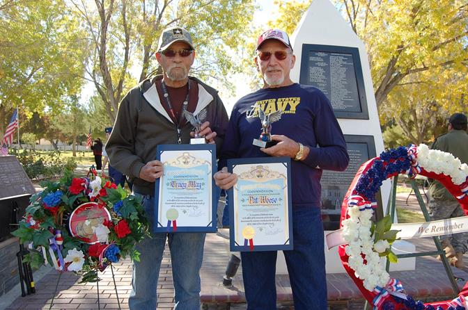 U.S. Army veteran Tracy May (left) and U.S. Navy veteran Pat Weese were the ceremony's Hometown Hero Honorees. Both have donated hundreds of hours over the years to complete various projects at Lancaster Cemetery. In fact, both were hard at work just a few days ago on the new benches and planters in the Veteran's Court of Honor, said Lancaster Cemetery District Manager Dayle DeBry.
