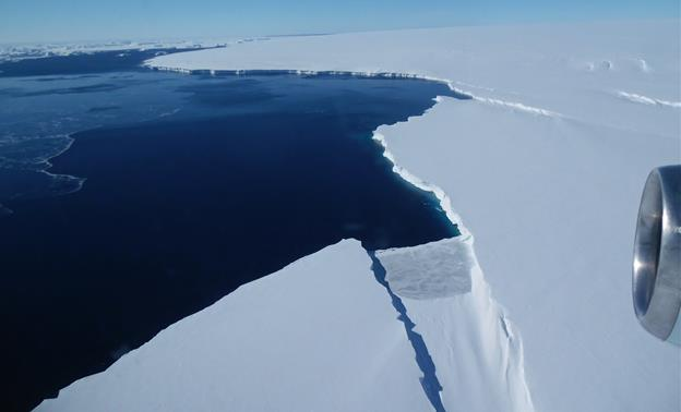 The Thurston Island calving front off of western Antarctica as seen from the window of NASA's DC-8 flying observatory. (NASA / Jim Yungel)