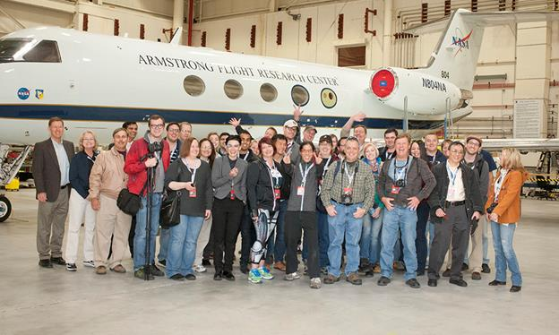NASA Social attendees, news media, project managers and escorts gather in front of NASA's Gulfstream III aircraft during an event at NASA Armstrong Flight Research Center. (Image Credit: NASA / Tom Tschida)