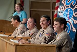 NASA pilots, from left, Hernan Posada, Tom Miller, Manny Antimisiaris and Scott Howe talk about their careers and flying NASA missions. (NASA / Tom Tschida)