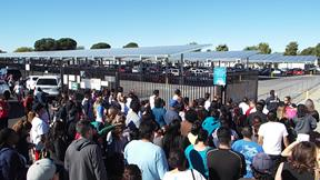 Worried parents gather outside Palmdale High School early Friday afternoon, after news of the first school lockdown. (JOHN MEZA)