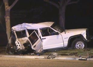 A man, woman and boy were thrown from this Jeep Cherokee and killed when the vehicle spun out of control after colliding with a Dodge Ram truck. (LUIS MEZA)