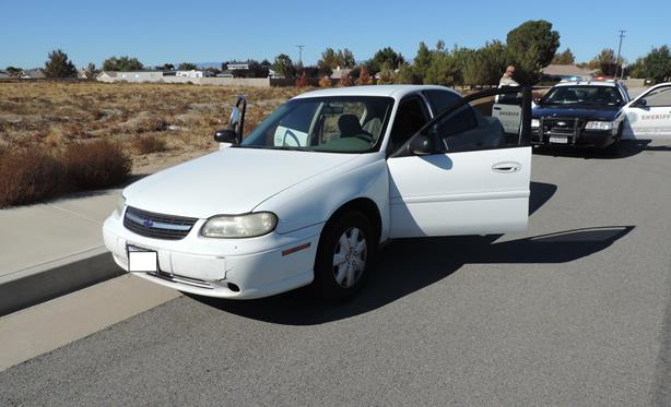 With the aid of the Sheriff's helicopter, deputies spotted three teen suspects running from this white 2004 Chevrolet Malibu. Jewelry stolen from one of the homes was found inside the vehicle, officials said. (Photo courtesy LASD)