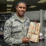 Airman 1st Class Ardell Reams, 412th Force Support Squadron, shows off his bag of holiday cookies. (U.S. Air Force photo by Rebecca Amber)