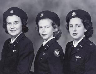 Young Flora Belle (Smith) Reece is shown between fellow classmates after graduating from B-26 school in Harlington, Texas. Reece was younger than her classmates because she entered the service at 19 when the minimum age was 21. (U.S. Air Force photo)