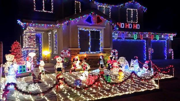 "This home is located at 6136 Brentwood Avenue in Lancaster. It features thousands of lights, handmade wooden decorations and ""snow""! Thank you, Roxanne Williams and Keith Chisam for sharing your home."