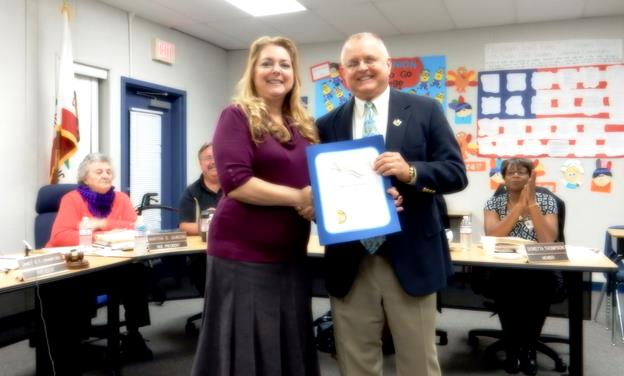 Janette Crawford is honored Dec. 8 with a certificate of appreciate from State Assemblyman Tom Lackey. (Contributed)