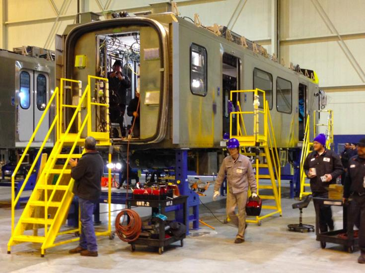 Kinkisharyo employees at the Palmdale Airport facility perform interior work on the light rail car shells, installing internal components, such as wiring, panels, and equipment prior to attaching the chassis. (photo by Jim E. Winburn)