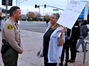 Rosamond resident Denise Ferguson speaks to Lt. Richard Martinez outside the Lancaster Sheriff's Station. Ferguson's grandson, Seth, organized the rally.