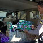 "Deputy Miguel Ruiz used the hummer to help distribute presents to local children on Christmas Eve last year. This Saturday, residents are invited to ""Stuff the Hummer"" with new unwrapped toys for the less fortunate children of Lancaster."