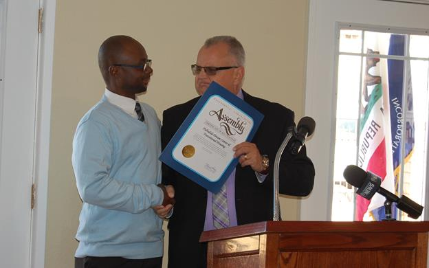 "California Assemblymember Tom Lackey presents a commendation certificate to the Palmdale Dream Center. ""I'm proud to be a supporter of something that needs to be replicated throughout this area,"" Lackey said. ""We're so grateful for the example that YouthBuild sets for the entire country."""