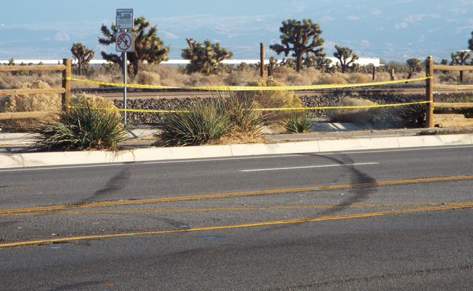 Skid marks were visible where the 2001 Chevy Tahoe ran off Sierra Highway, just south of Avenue M, killing passenger Jackeline Abigail Matias-DeLeon of Palmdale. (Photo by LUIS MEZA)