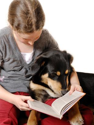"""Kids are encouraged to read to friendly dogs in the """"Books and Barks"""" program, returning Jan. 27."""