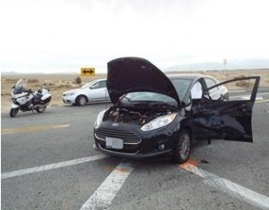 A female driver, the sole occupant in the car, was transported to a local hospital with injuries. (LUIS MEZA)