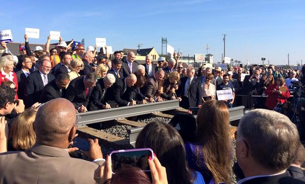 Gov. Brown and other dignitaries sign the ceremonial high-speed rail at the official groundbreaking ceremony Tuesday, Jan. 6, in downtown Fresno. (Photo courtesy California High-Speed Rail Authority.)