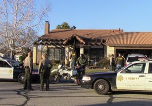 A team of officers on Saturday searched Moore's residence on the 4500 block of Table Mountain Road. (LUIS MEZA)