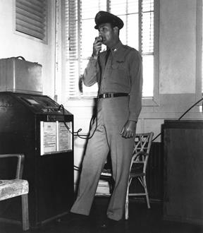 Capt. Fitz Fulton, just beginning his career, is shown here using the radio at Flight Test Operations in April 1951. (Air Force photo)