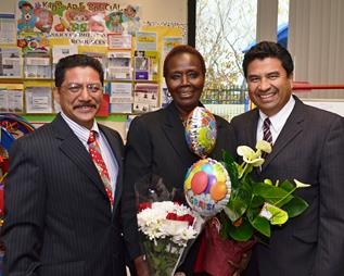 When the official announcement was made in December, Zulu received a surprise visit by Superintendent Raul Maldonado (right) and Palmdale Elementary Teachers' Association President Hugo Estrada (left. [Contributed]