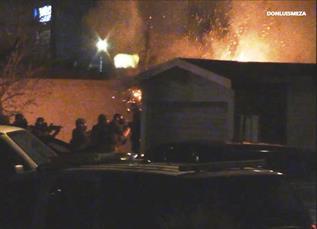 A sawed off shotgun was found inside the house, officials said. (LUIS MEZA)