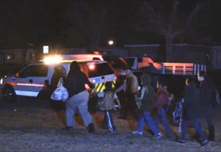 During the hours-long standoff, surrounding homes in the area were evacuated. (LUIS MEZA)