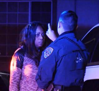 The female driver was given a field sobriety test, and then she was handcuffed and taken into custody.  (LUIS MEZA)