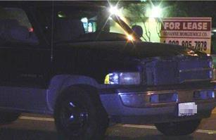 The pickup truck's driver remained at the scene and was not detained. (LUIS MEZA)