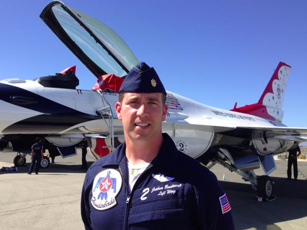 Standing in front of the Lockheed Martin F-16D Fighting Falcon he flies for the USAF Thunderbirds, Major Joshua Boudreaux is the left wing pilot for the Air Demonstration Squadron. (Jim E. Winburn)