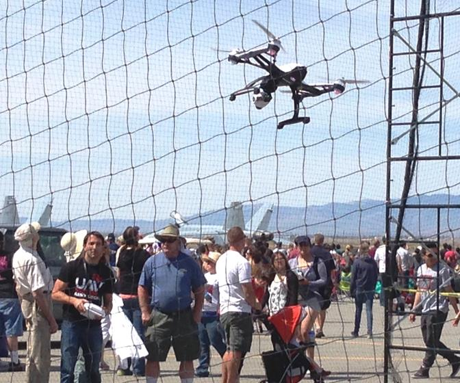 A Dronefly representative shows off the latest aerial technology of his company's Phantom model to passersby at the air show March 22. (Photo by JIM WINBURN)