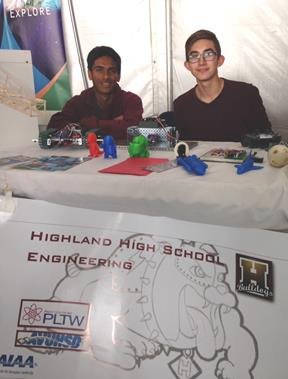 Representatives of Highland High School's Robotics Team & Engineering Club, Paul Ajodha and Michael Shaffer, inform kids and parents at the air show's STEM exhibits about their school's Pathway to Engineering Program program. [JIM WINBURN]