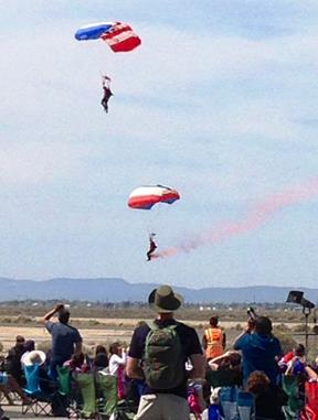 After jumping from Matt Younkin's Beech 18, the Patriot Parachute Team - all former active duty Navy SEALs - perform to a cheering audience at Fox Airfield.