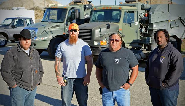 "(L to R) Moses Zamora, Neil Edwards, Robin ""Bubba"" Hairston, and Derrick Shannon are the heavy equipment operators who saved the life of a coworker who collapsed in his flightline sweeper March 13. (U.S. Air Force photo by Jet Fabara)"