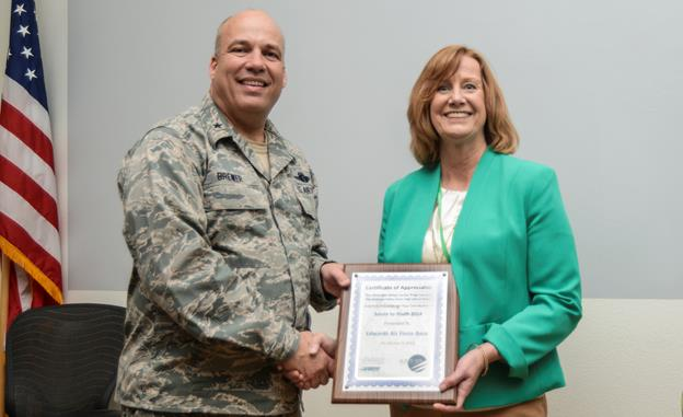 Betsy McKinstry, Antelope Valley Union High School District College and Career director, presented Brig. Gen. Michael Brewer, 412th Test Wing commander, with a certificate of appreciation for Edwards AFB's participation in the district's 2014 Salute to Youth program. The presentation was made during the weekly test wing staff meeting March 17. (U.S. Air Force photo by Rebecca Amber)