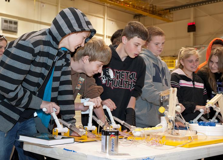 Student use the pneumatic robotic arms (education display).