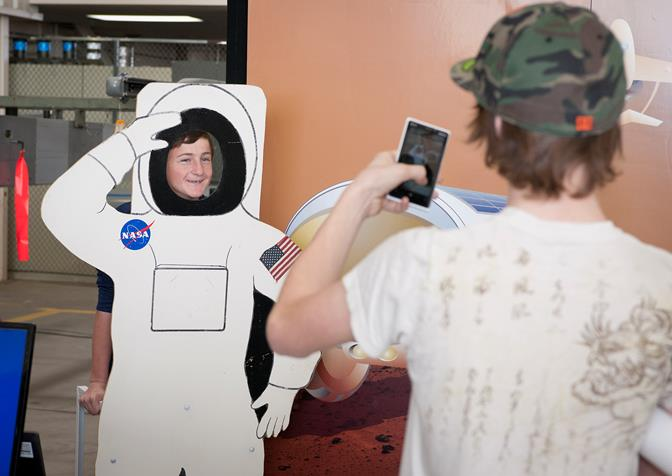 Students have some fun with an astronaut cutout.
