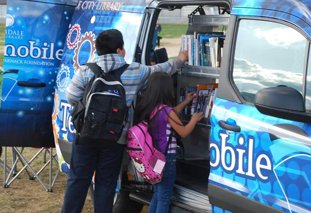 Student check out books from the Techmobile. (Contributed)
